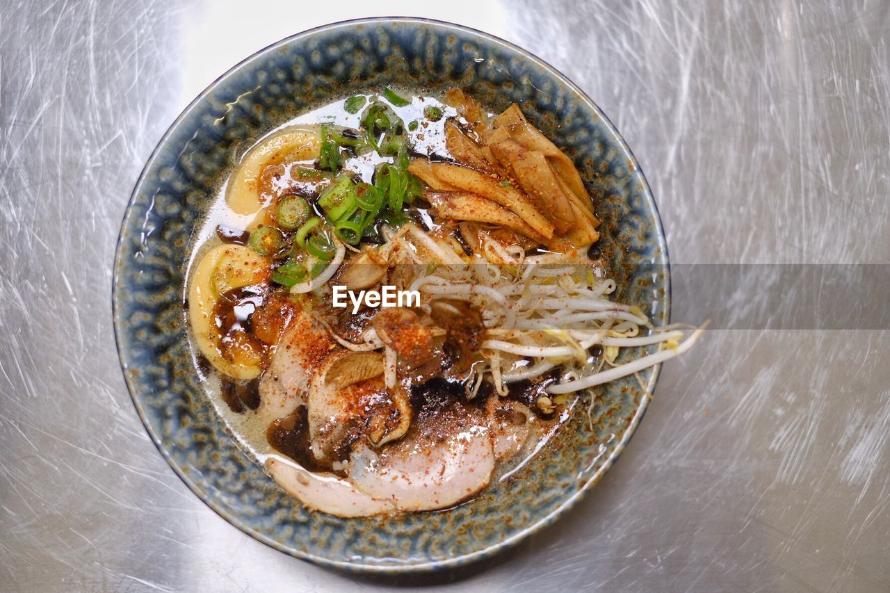 food, ready-to-eat, food and drink, freshness, bowl, table, healthy eating, high angle view, wellbeing, indoors, still life, no people, pasta, directly above, close-up, italian food, plate, asian food, meat, garnish, japanese food, chinese food