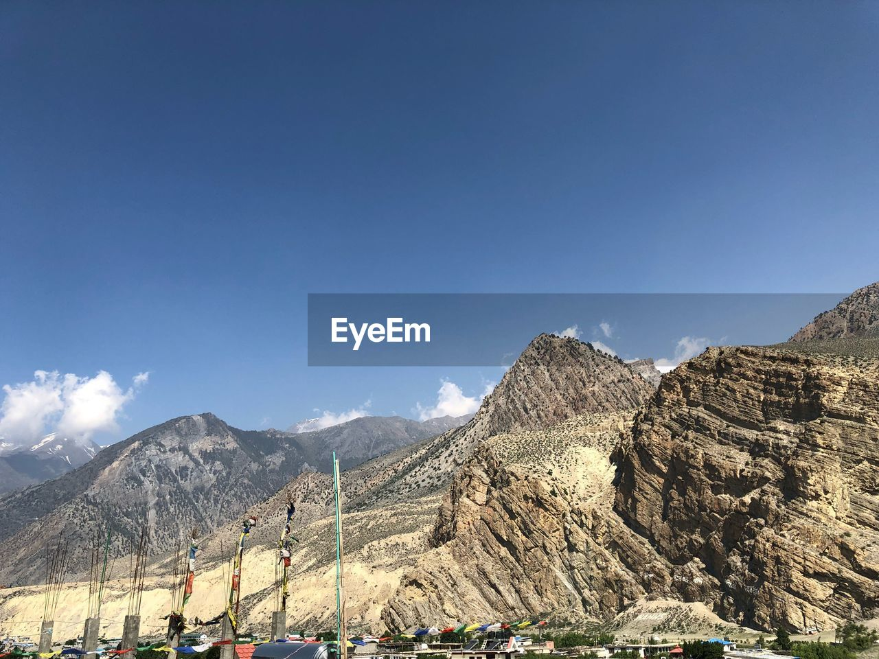 PANORAMIC VIEW OF MOUNTAIN AGAINST BLUE SKY