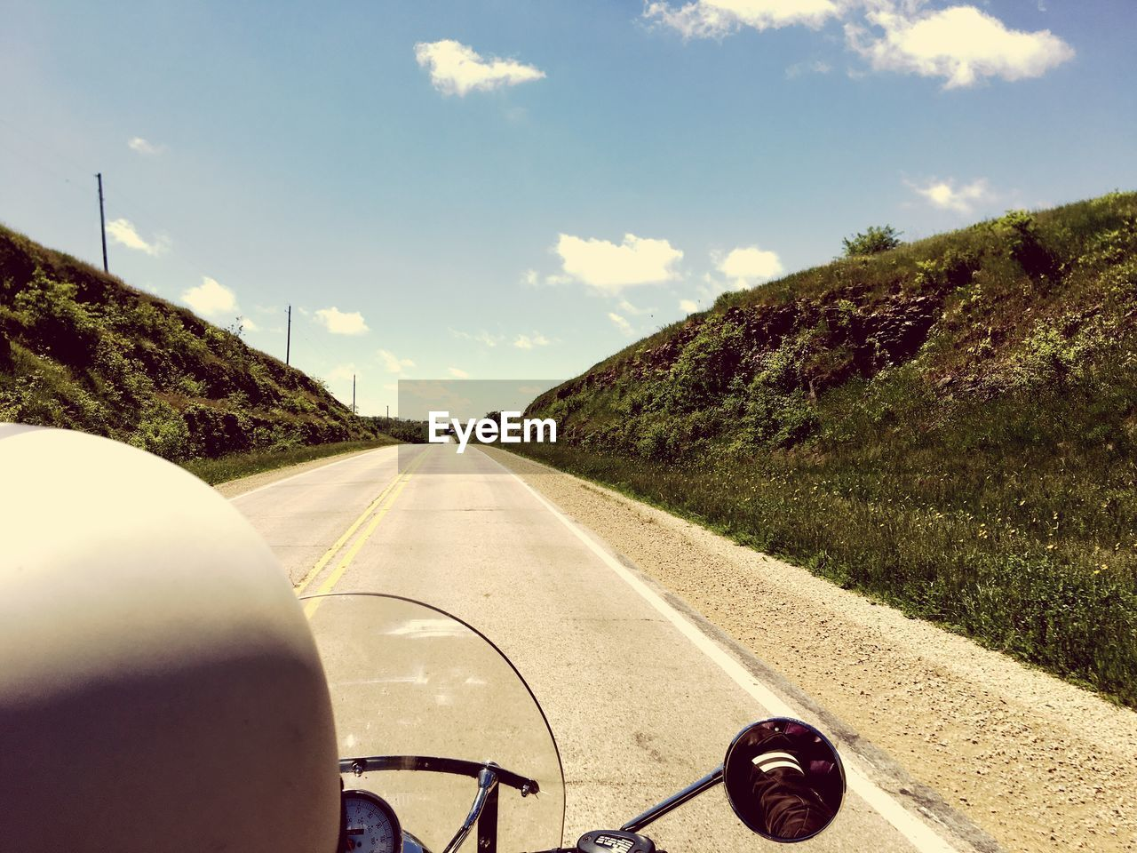 road, transportation, personal perspective, human body part, the way forward, sky, human hand, cloud - sky, car point of view, mode of transport, one person, windshield, landscape, day, land vehicle, car interior, real people, mountain, nature, scenics, outdoors, close-up, people
