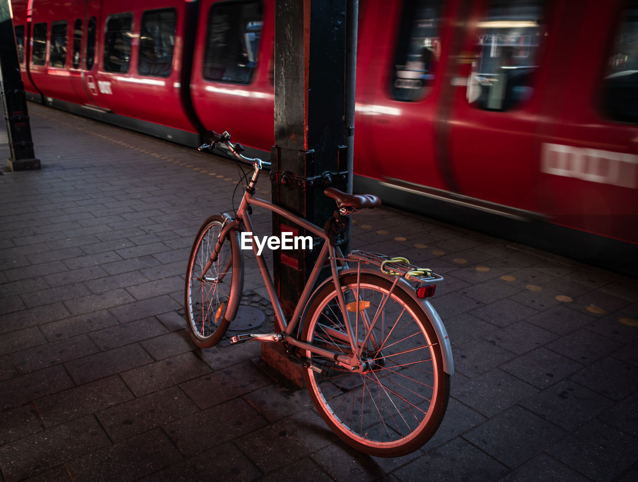 Bicycle Parked At Railroad Station
