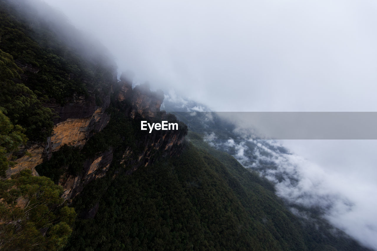 mountain, nature, fog, beauty in nature, scenics, weather, day, no people, tranquil scene, mist, outdoors, tranquility, cold temperature, mountain range, landscape, winter, snow, water, tree, sky, power in nature