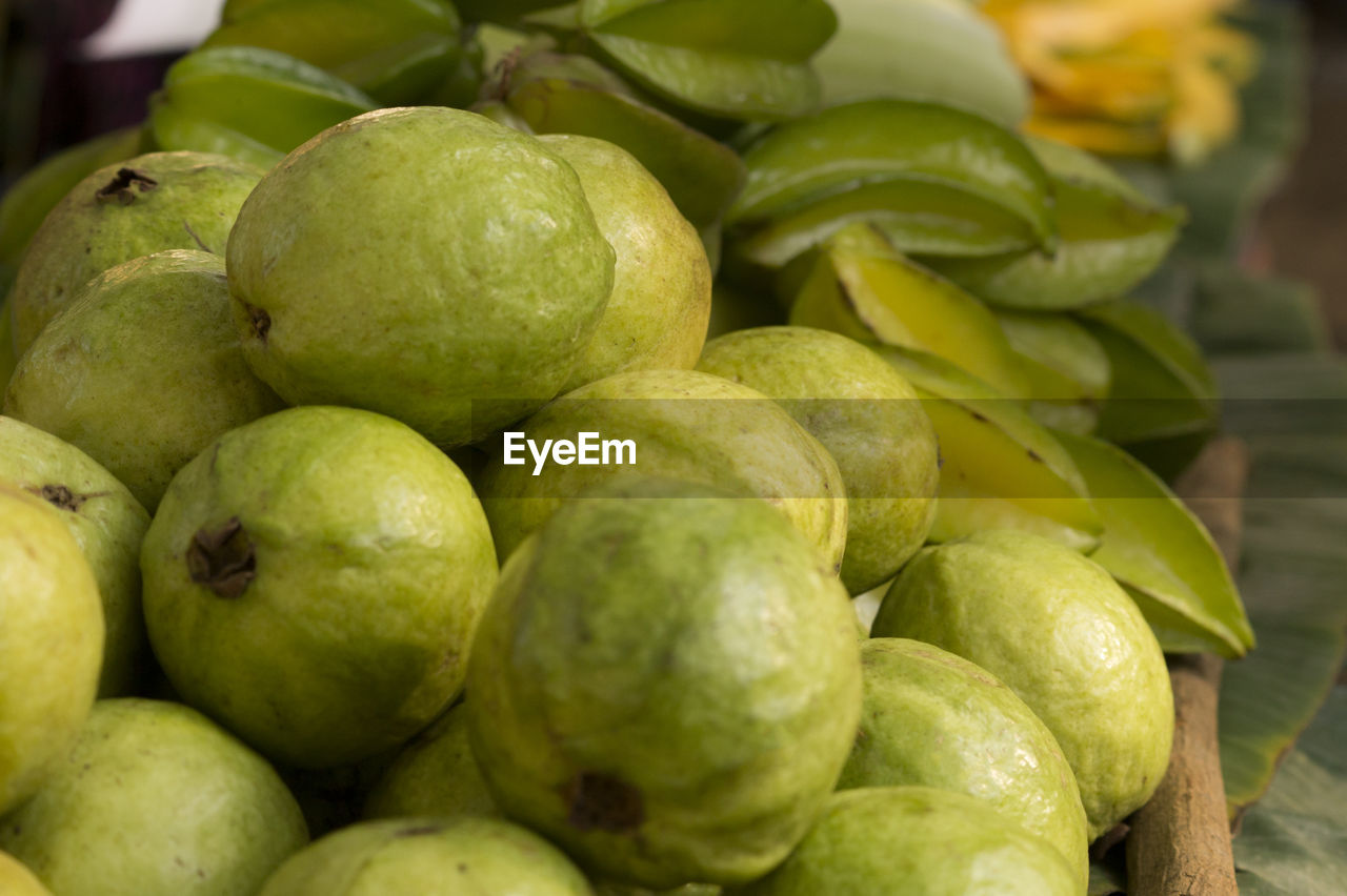 food and drink, fruit, healthy eating, food, freshness, green color, no people, close-up, market, large group of objects, leaf, day, outdoors