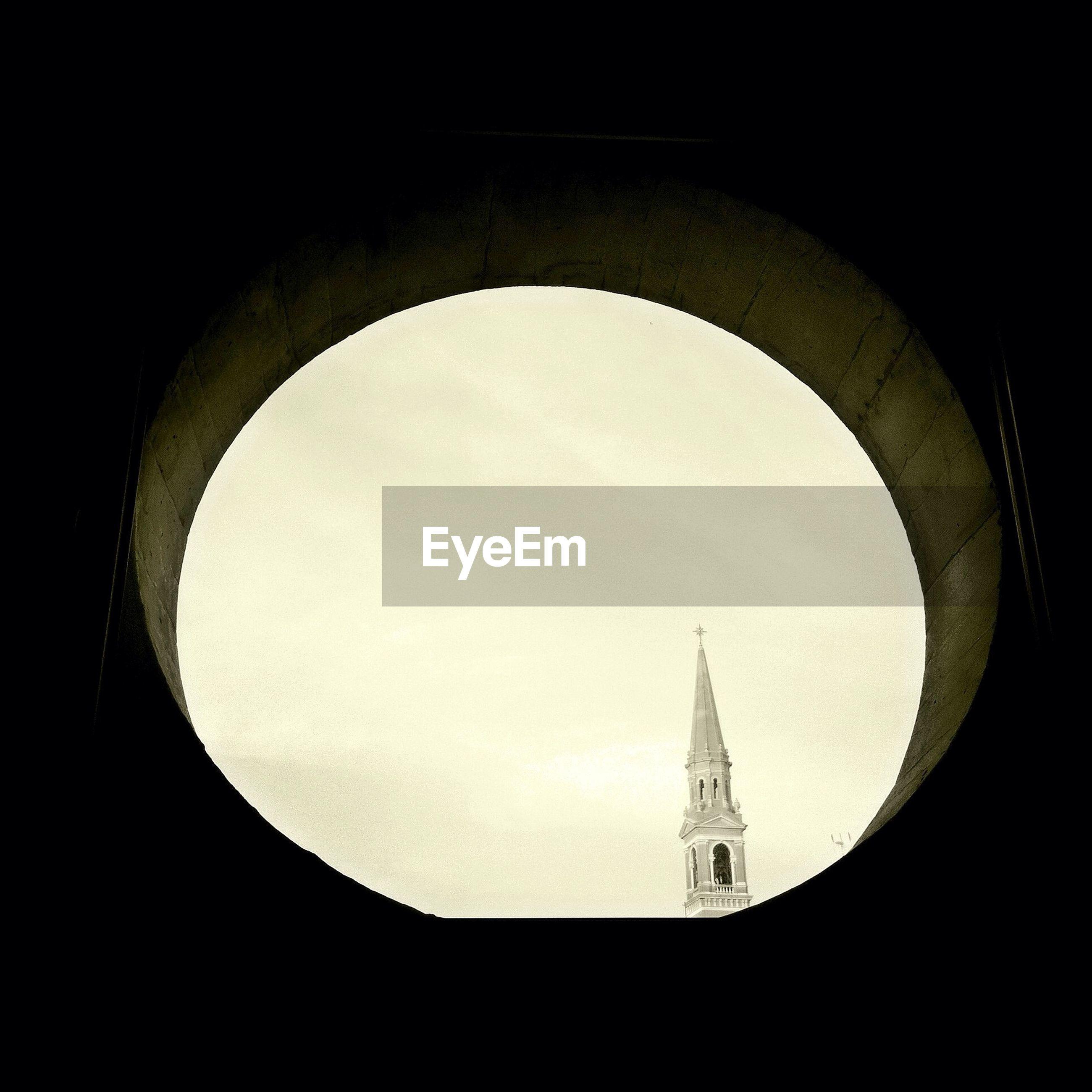 Church seen through circular window