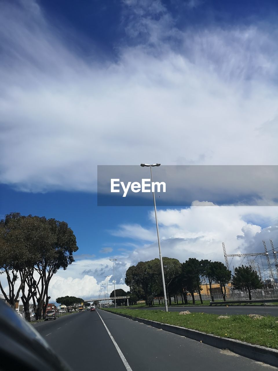 cloud - sky, sky, transportation, road, tree, street, car, motor vehicle, plant, nature, no people, mode of transportation, land vehicle, sign, street light, direction, the way forward, symbol, marking, beauty in nature, outdoors, car point of view