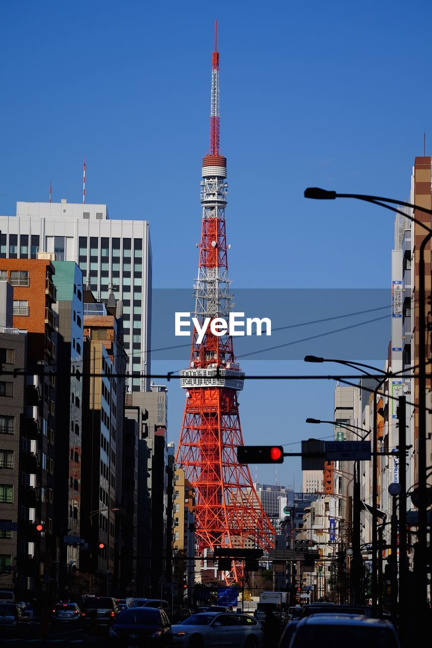 Street view of tokyo tower against sky