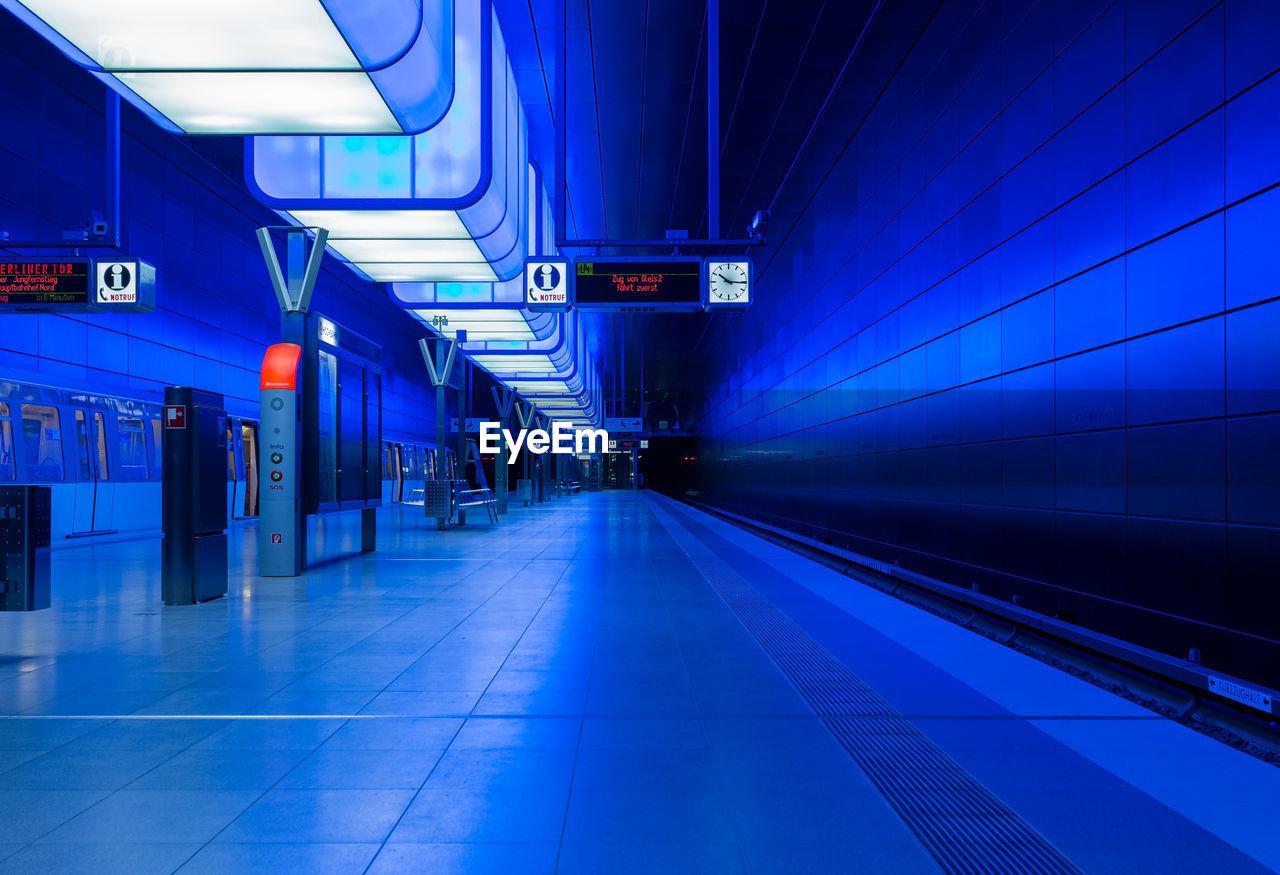transportation, public transportation, illuminated, railroad station, rail transportation, railroad station platform, train - vehicle, the way forward, blue, indoors, night, no people, architecture
