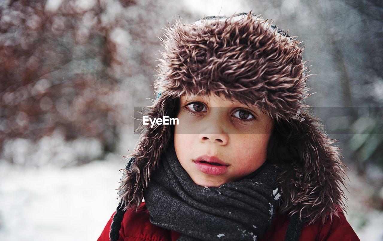 Portrait Of Boy In Fur Coat