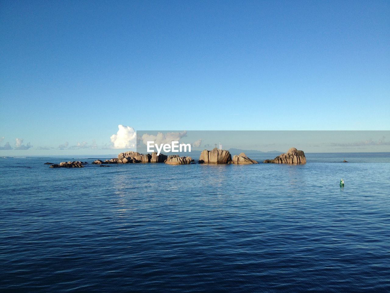 sea, tranquility, blue, scenics, water, beauty in nature, nature, tranquil scene, waterfront, outdoors, copy space, no people, day, sky, nautical vessel, horizon over water, clear sky, architecture