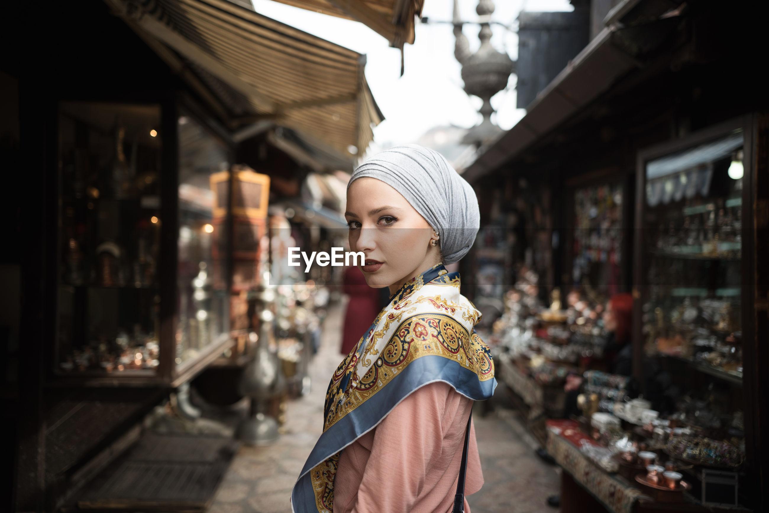 Woman standing amongst market stalls