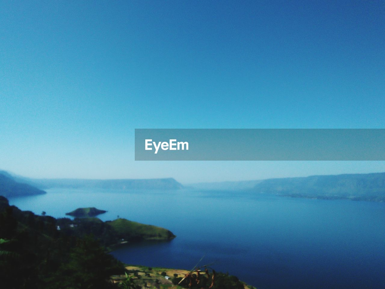 sky, water, copy space, scenics - nature, tranquility, beauty in nature, tranquil scene, nature, blue, sea, no people, mountain, clear sky, day, outdoors, environment, waterfront, landscape