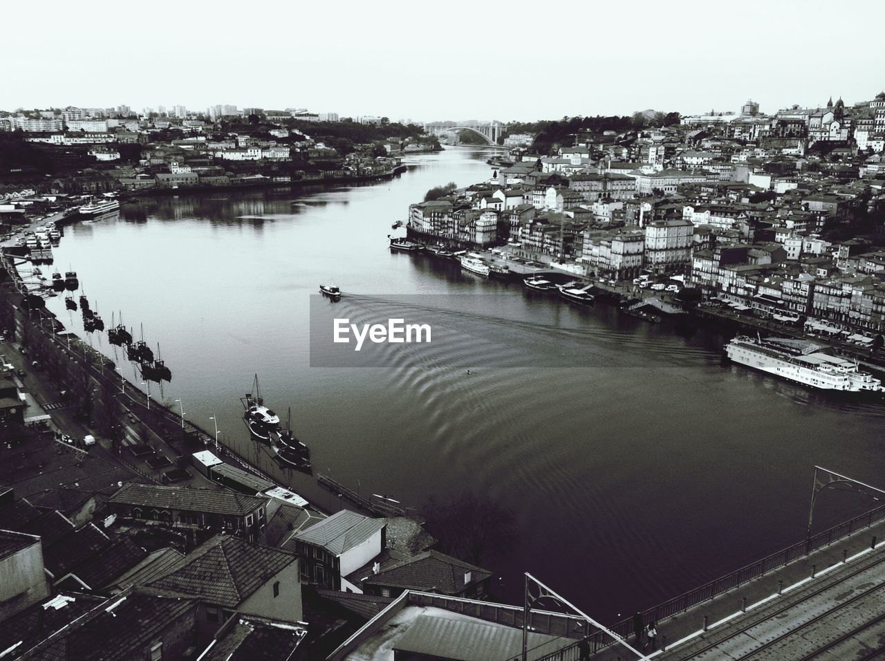 High angle view of river amidst residential district against sky