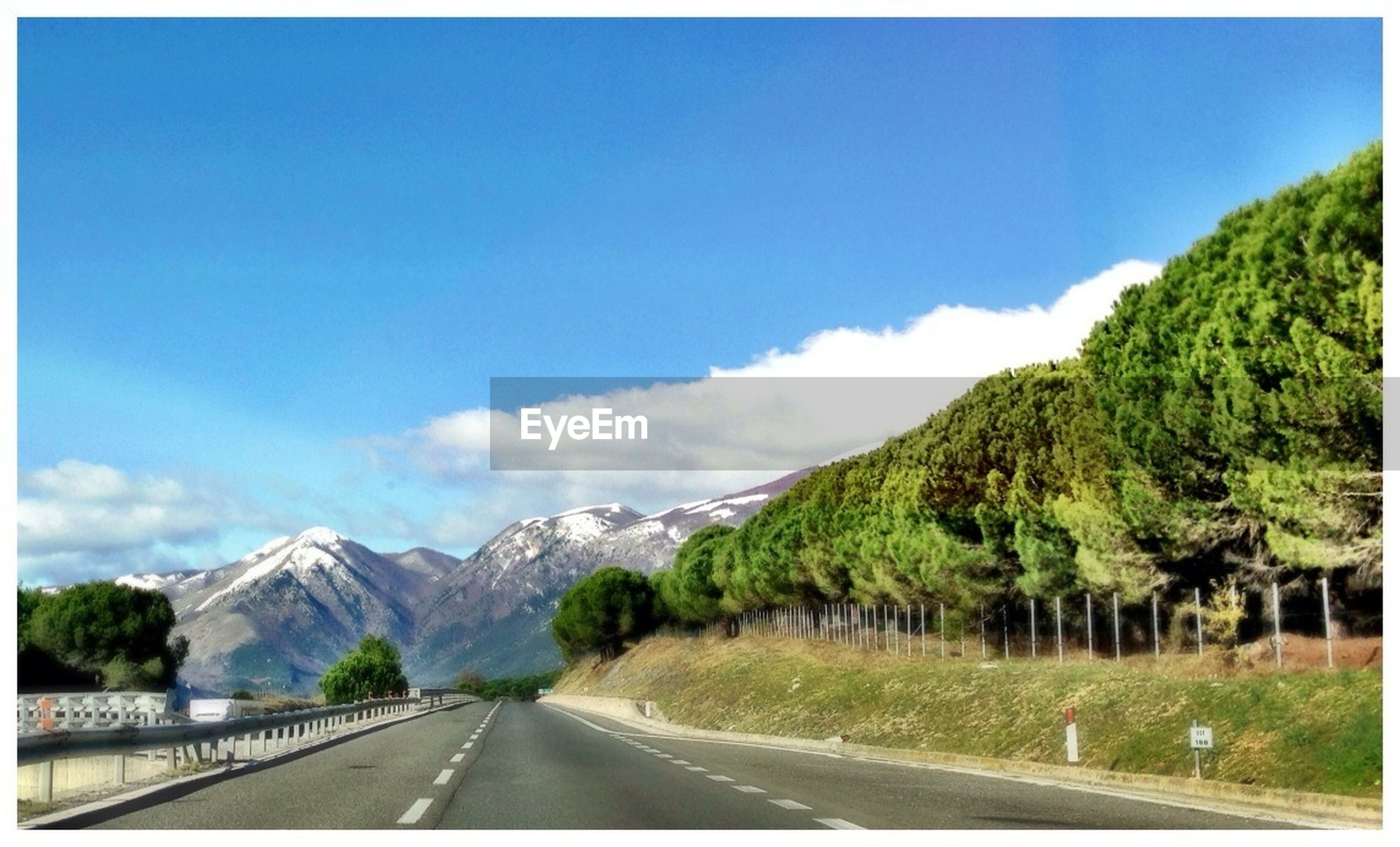 road, the way forward, transportation, mountain, sky, diminishing perspective, transfer print, road marking, country road, vanishing point, blue, mountain range, tranquil scene, scenics, tranquility, landscape, nature, beauty in nature, auto post production filter, empty road