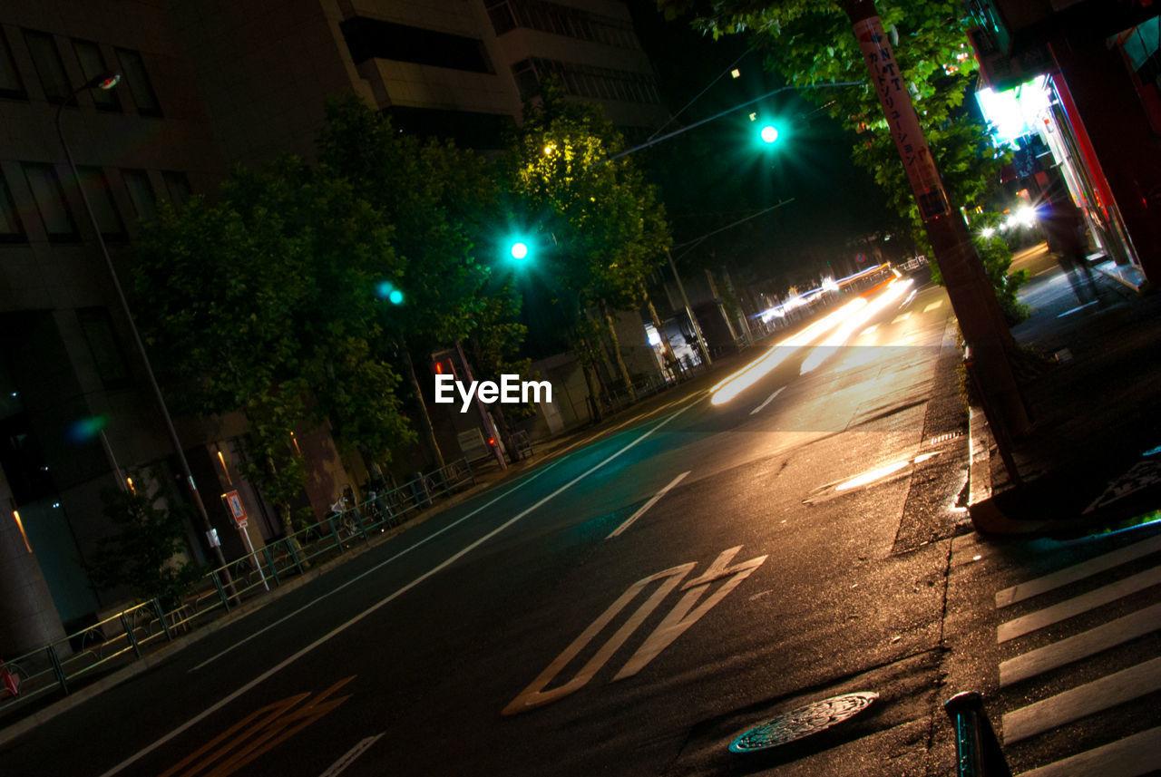 illuminated, night, street, speed, light trail, long exposure, street light, road, building exterior, transportation, motion, high street, no people, outdoors, architecture, city