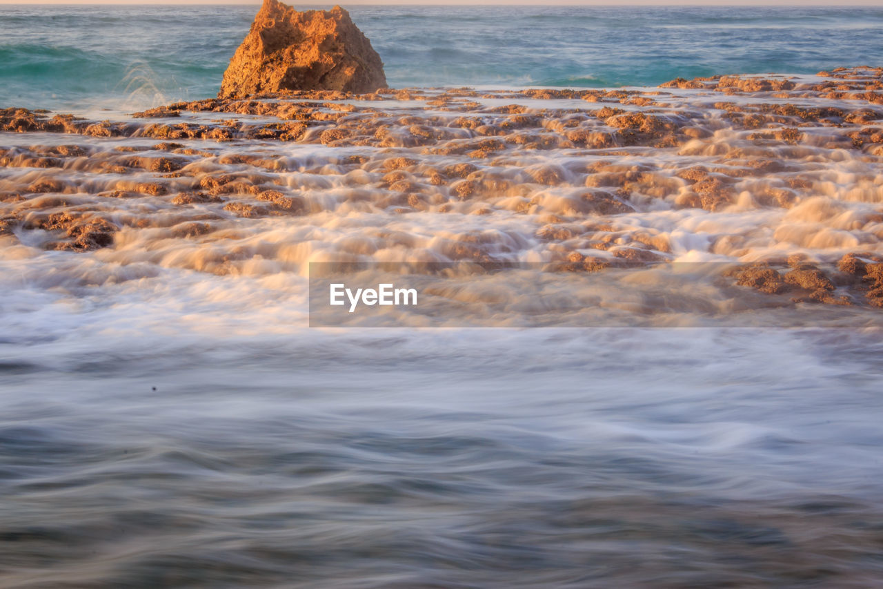 water, sea, nature, beauty in nature, wave, rock - object, waterfront, tranquility, no people, outdoors, scenics, beach, day, power in nature, horizon over water, sky