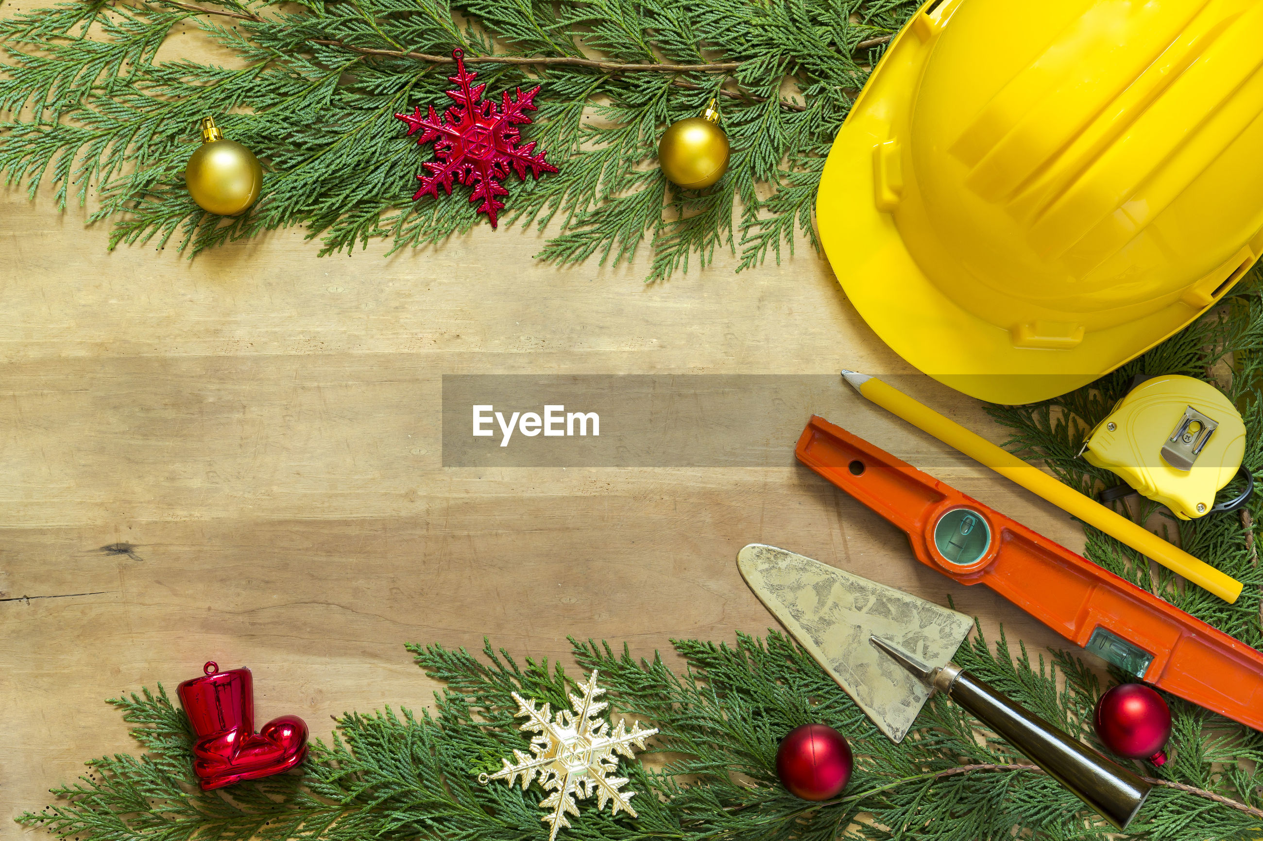Christmas decoration and work tools on table