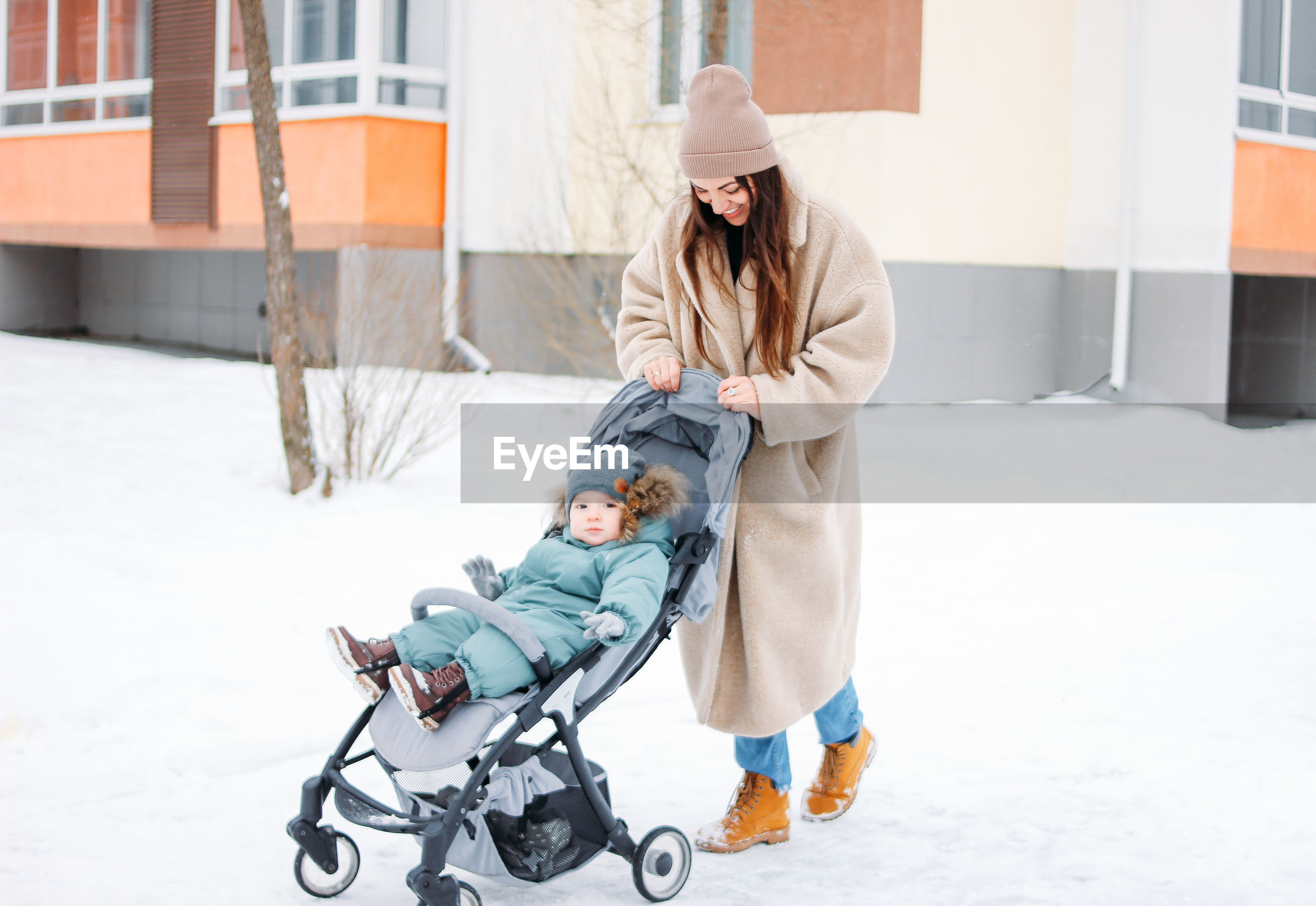 FULL LENGTH OF CHILD IN SNOW DURING SNOWFALL