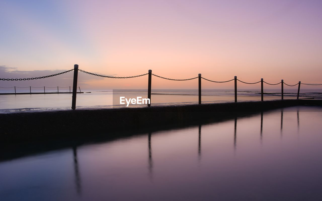 water, sky, sunset, connection, bridge, bridge - man made structure, built structure, architecture, engineering, nature, beauty in nature, suspension bridge, transportation, waterfront, scenics - nature, tranquility, river, reflection, outdoors, bay
