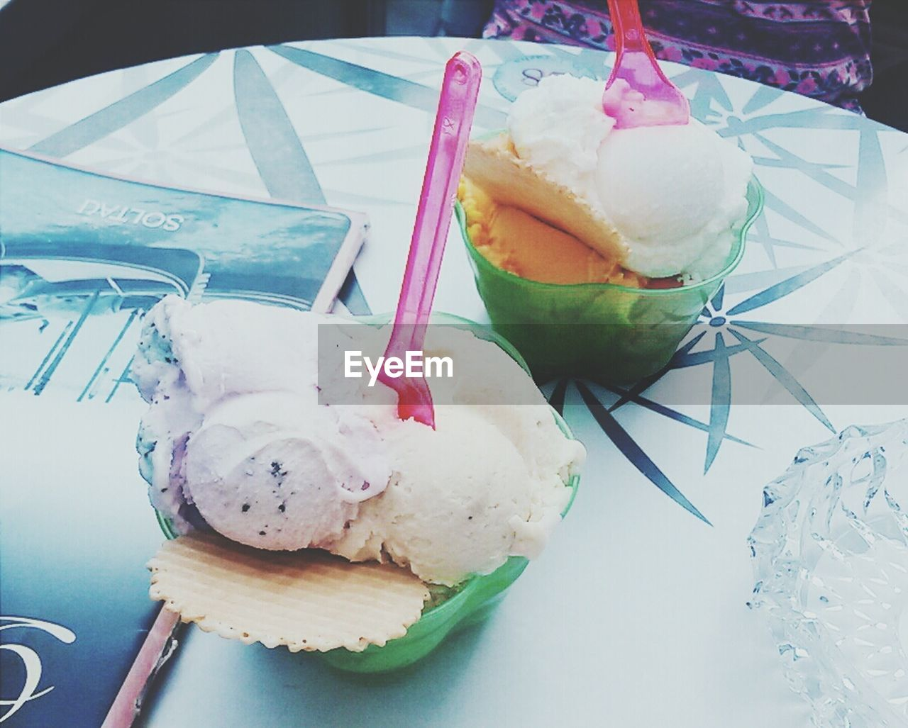 Close-Up Of Vanilla Ice Creams In Bowls On Table