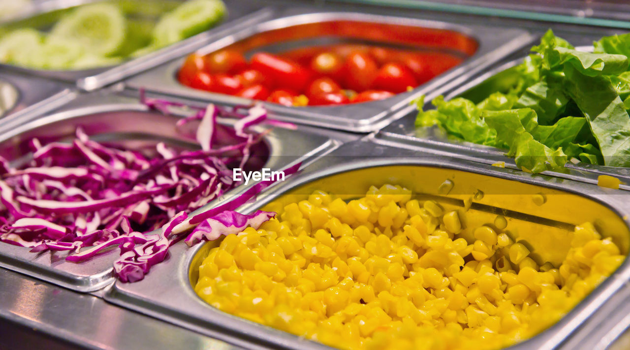 HIGH ANGLE VIEW OF VARIOUS VEGETABLES IN CONTAINER