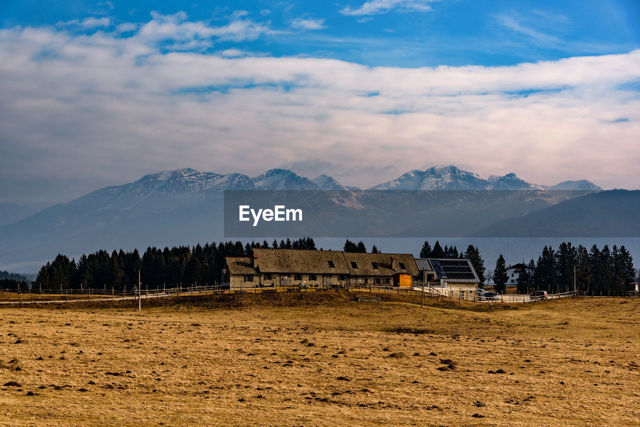 mountain, sky, cloud - sky, scenics - nature, environment, mountain range, landscape, tranquil scene, beauty in nature, nature, no people, built structure, architecture, tree, tranquility, building exterior, non-urban scene, land, plant, field, mountain peak
