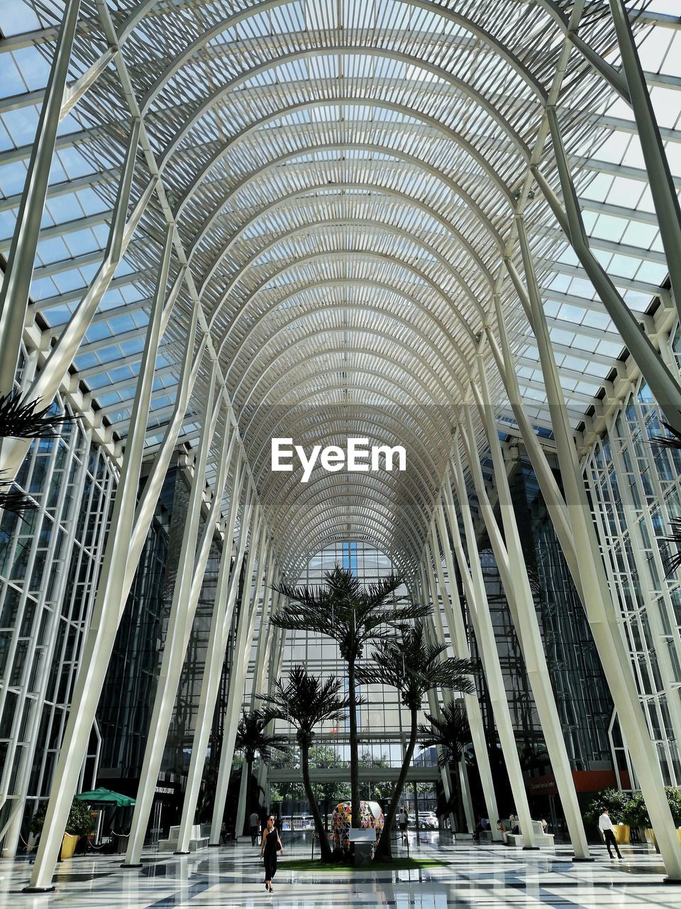 architecture, built structure, modern, indoors, ceiling, incidental people, arch, men, real people, glass - material, walking, day, city, pattern, group of people, travel, design, travel destinations, lifestyles, shopping mall, architectural column