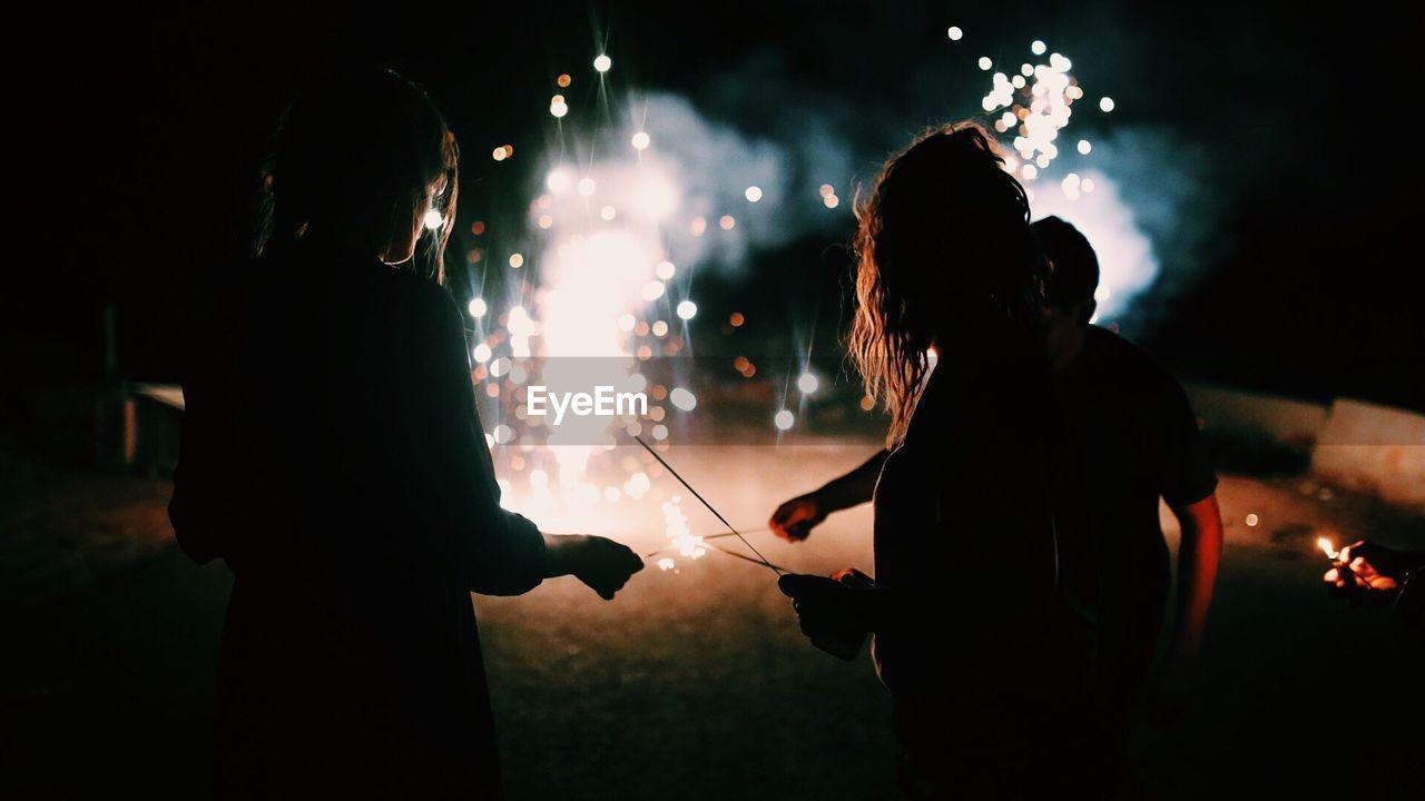 Silhouette People Celebrating Diwali At Night