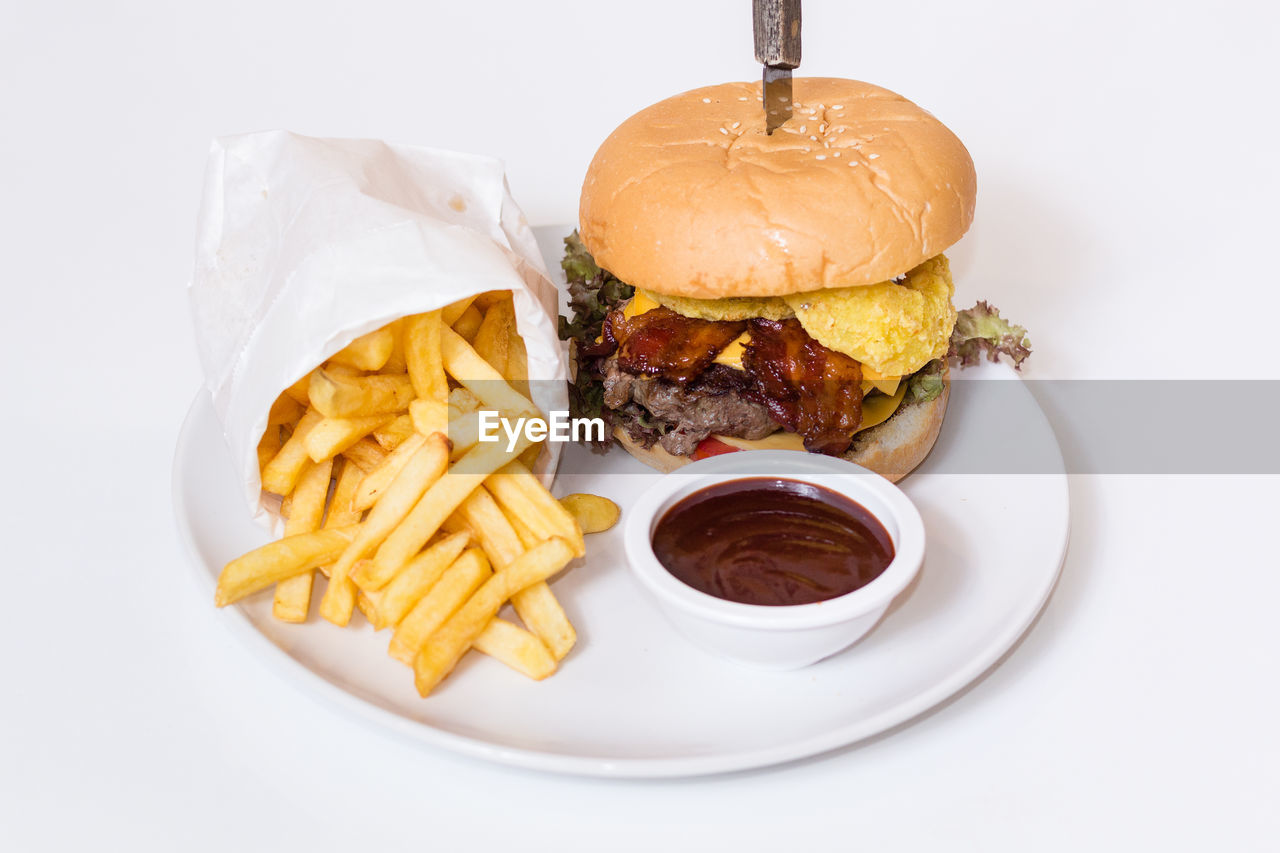 french fries, unhealthy eating, burger, food and drink, hamburger, prepared potato, food, ready-to-eat, still life, fast food, indulgence, white background, bun, no people, studio shot, ketchup, deep fried, freshness, plate, close-up, indoors, dip
