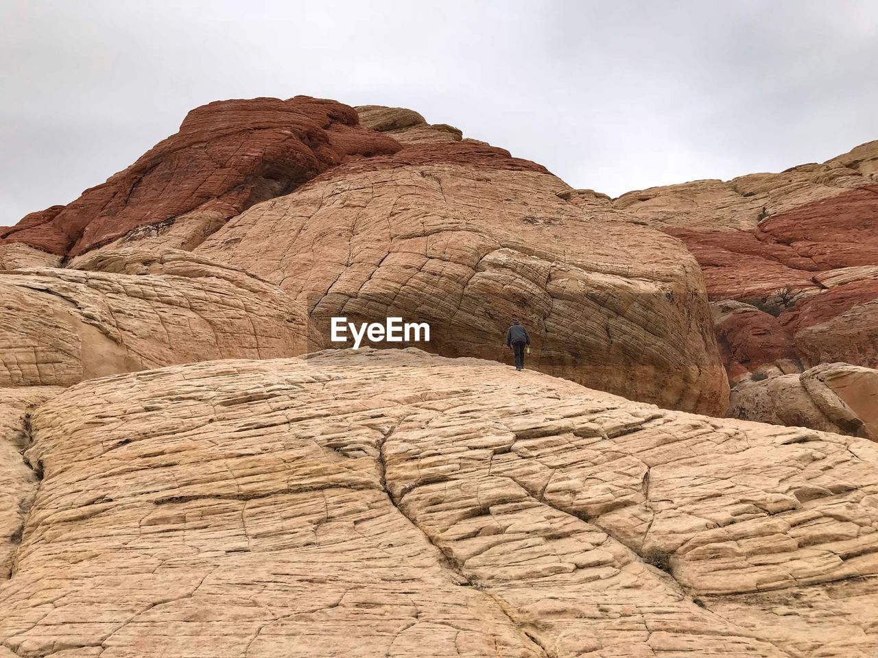 Low angle view of man on rock formation