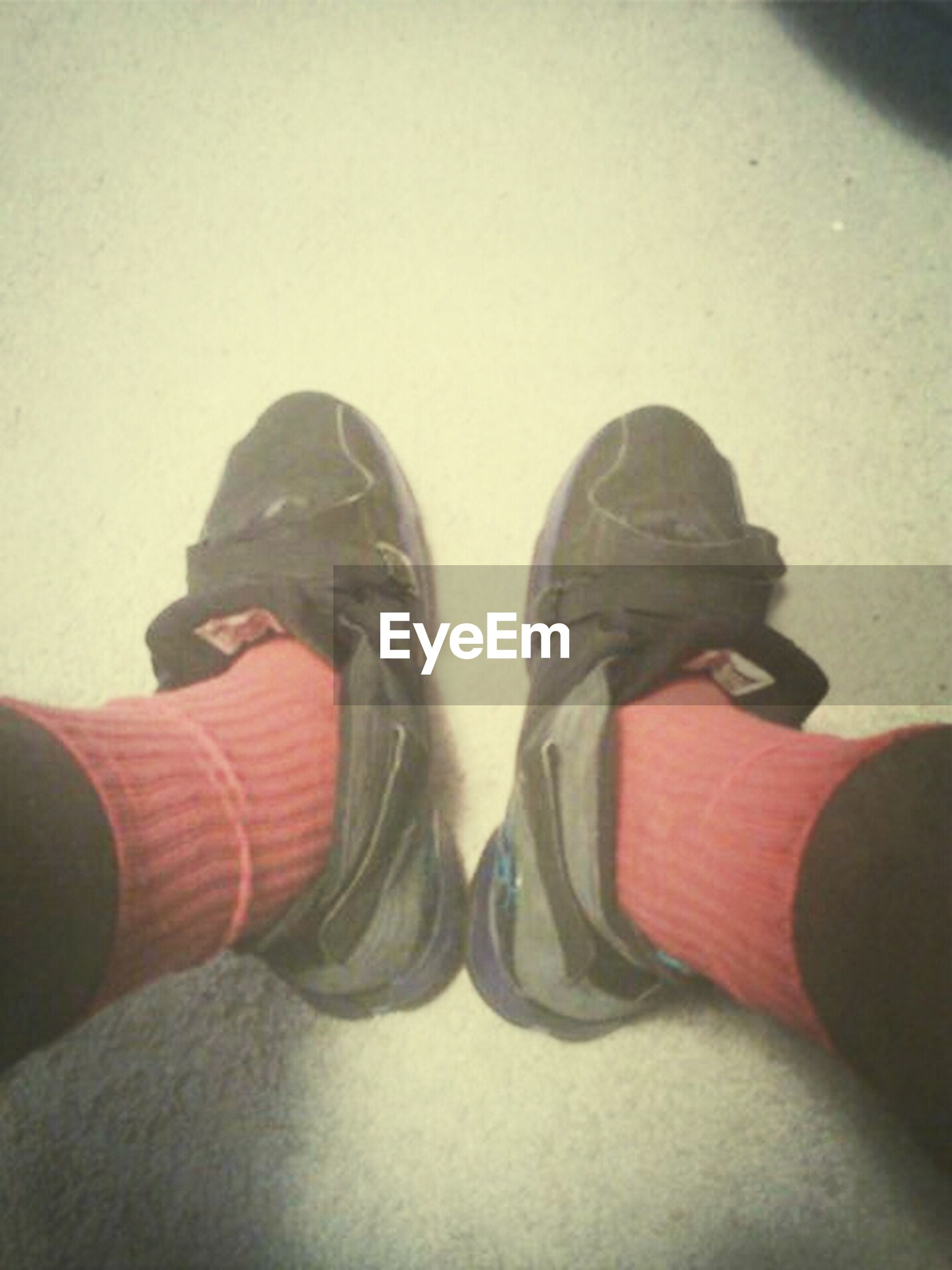 shoe, low section, person, lifestyles, leisure activity, men, footwear, personal perspective, high angle view, standing, human foot, fashion, jeans, unrecognizable person, indoors, sitting