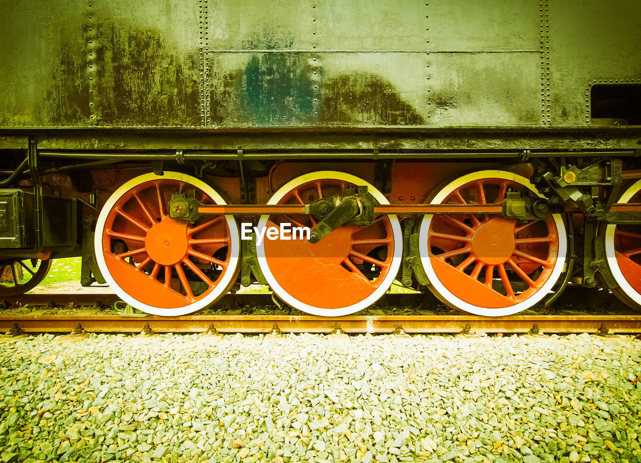 transportation, rail transportation, no people, train, day, train - vehicle, nature, outdoors, railroad track, plant, track, public transportation, mode of transportation, architecture, orange color, wheel, yellow, green color, field, side by side