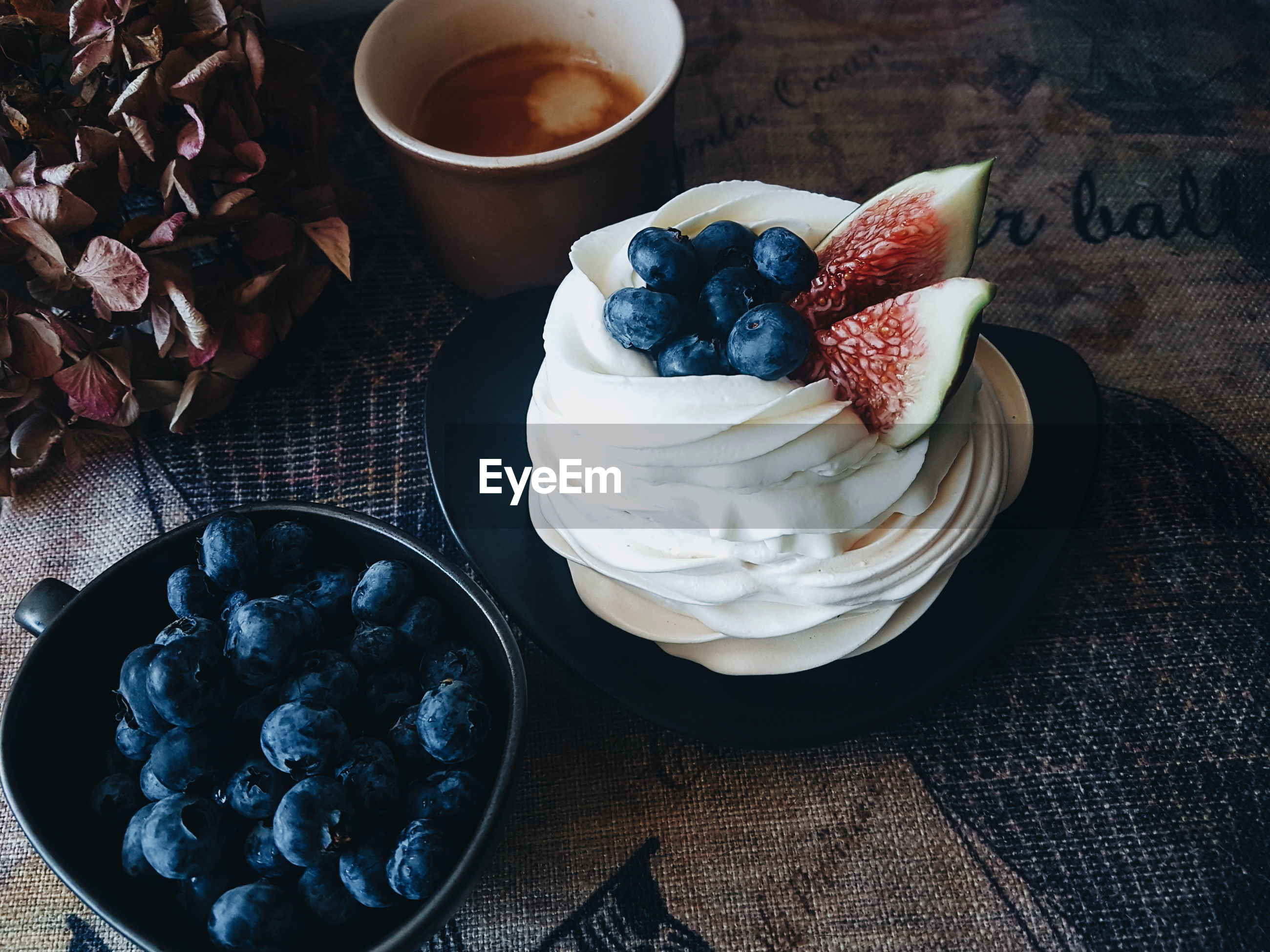 High angle view of pavlova and blueberries on table