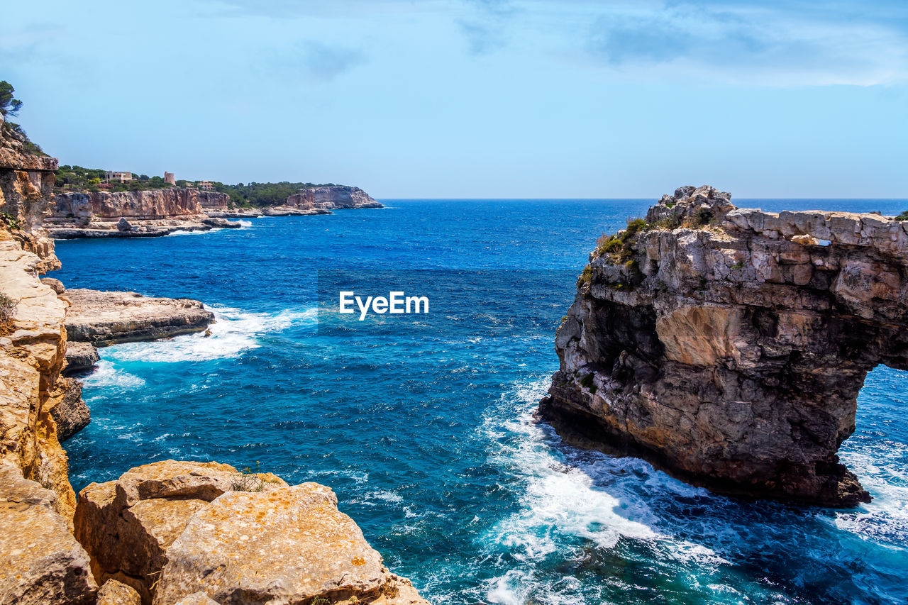 sea, water, scenics - nature, rock, rock - object, sky, beauty in nature, horizon over water, horizon, solid, rock formation, land, tranquil scene, blue, nature, tranquility, idyllic, day, no people, outdoors, rocky coastline, eroded, turquoise colored