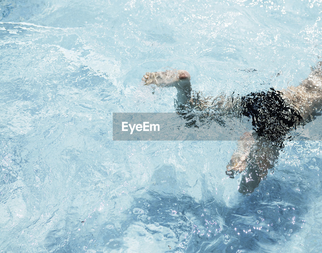 water, motion, splashing, swimming, sport, lifestyles, one person, men, real people, nature, sea, day, leisure activity, waterfront, healthy lifestyle, pool, outdoors, strength, swimming pool