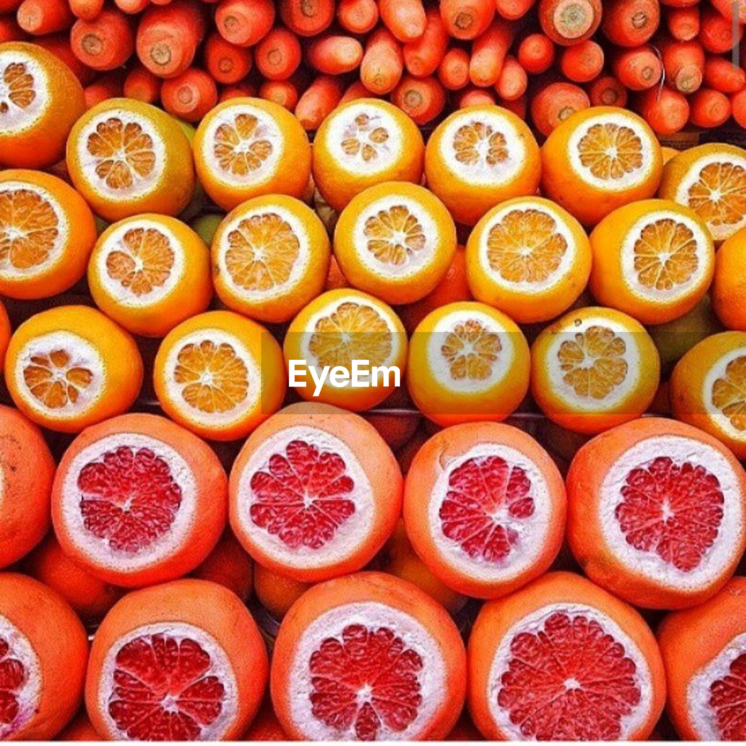 food and drink, abundance, large group of objects, food, freshness, indoors, full frame, backgrounds, for sale, still life, variation, arrangement, close-up, sweet food, high angle view, retail, collection, repetition, choice, in a row