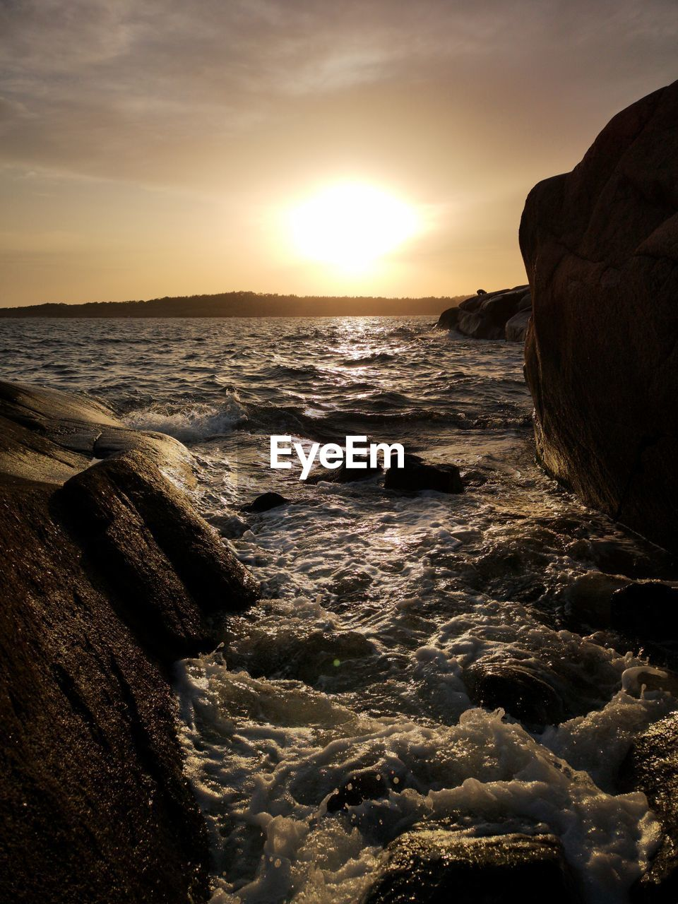 sky, sea, sunset, water, beauty in nature, scenics - nature, rock, land, solid, horizon, rock - object, beach, motion, nature, no people, horizon over water, tranquil scene, tranquility, sun, outdoors, rocky coastline