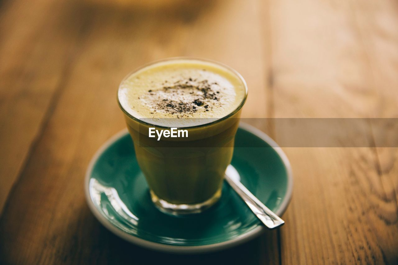 drink, food and drink, refreshment, table, coffee - drink, still life, coffee, frothy drink, saucer, mug, freshness, cup, coffee cup, crockery, wood - material, indoors, close-up, food, hot drink, focus on foreground, no people, latte, glass, non-alcoholic beverage, froth