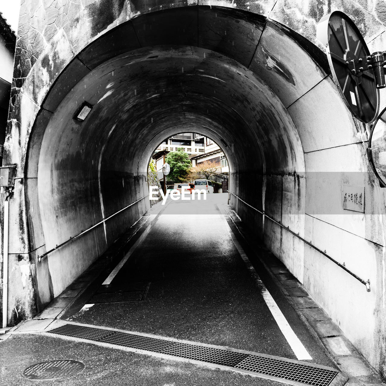 Tunnel leading towards building