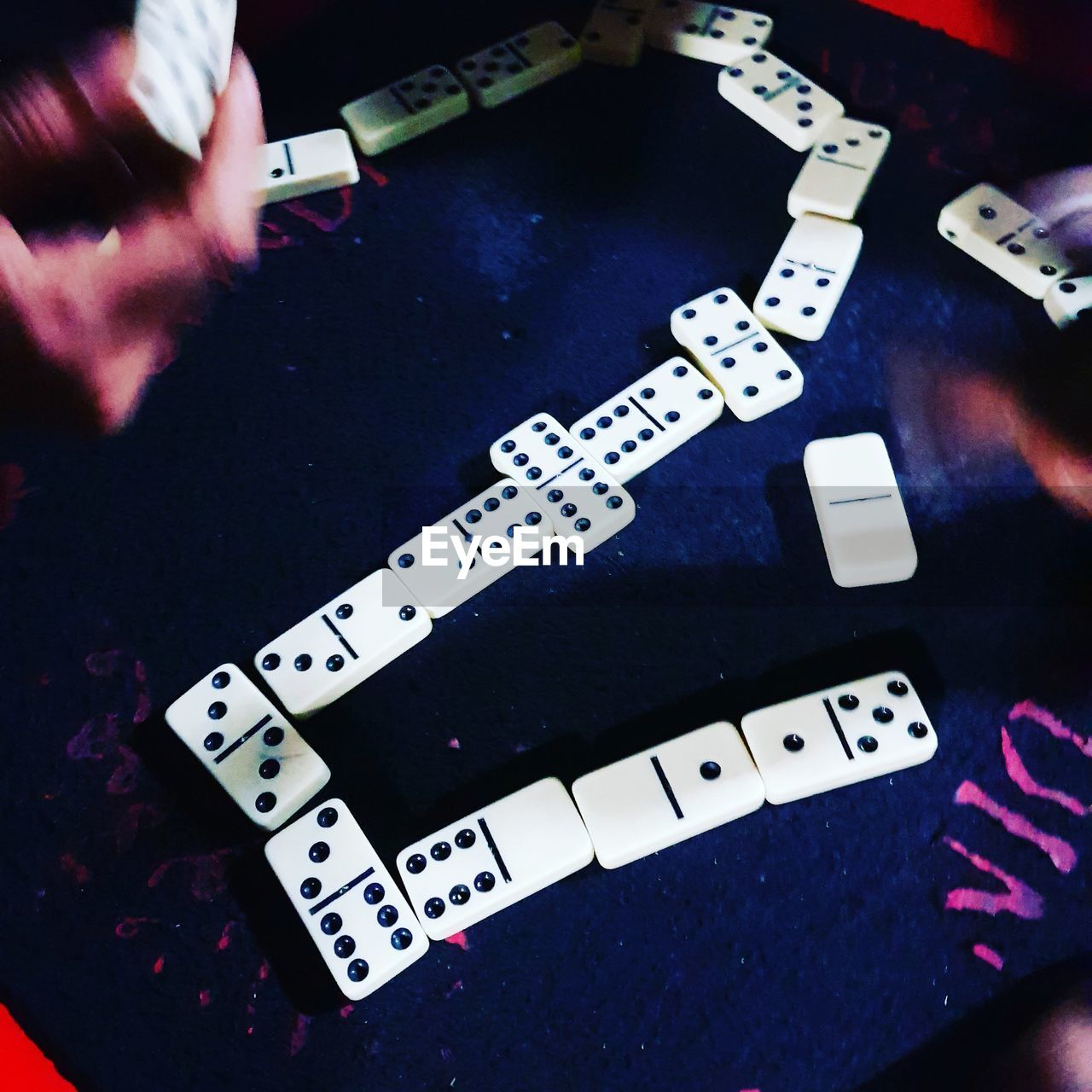 indoors, human hand, close-up, leisure games, table, real people, arts culture and entertainment, high angle view, human body part, gambling, leisure activity, one person, day