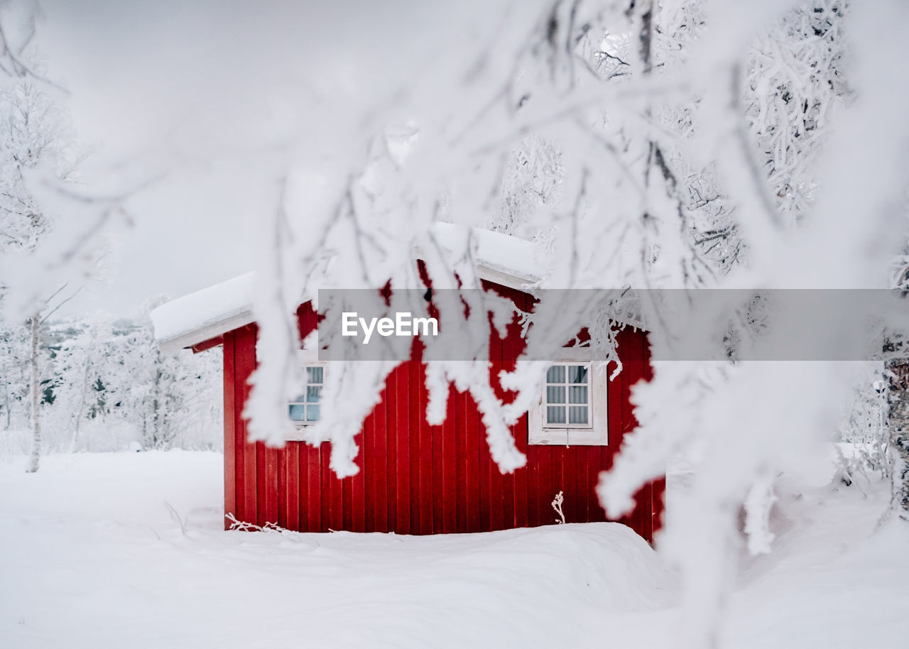 snow, winter, cold temperature, white color, architecture, built structure, day, covering, nature, building exterior, no people, building, red, tree, field, land, beauty in nature, outdoors, communication