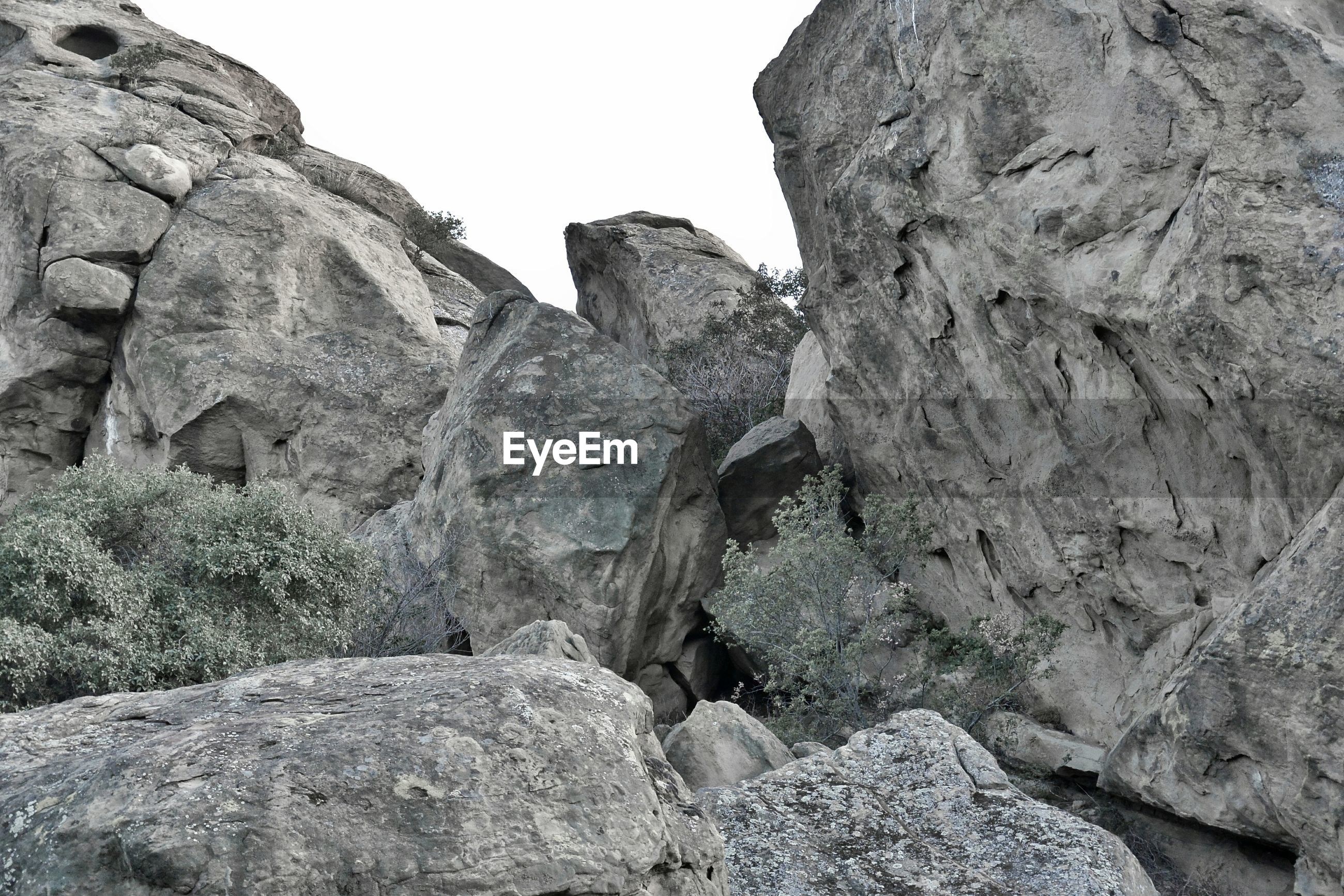 Low angle view of rocks on field
