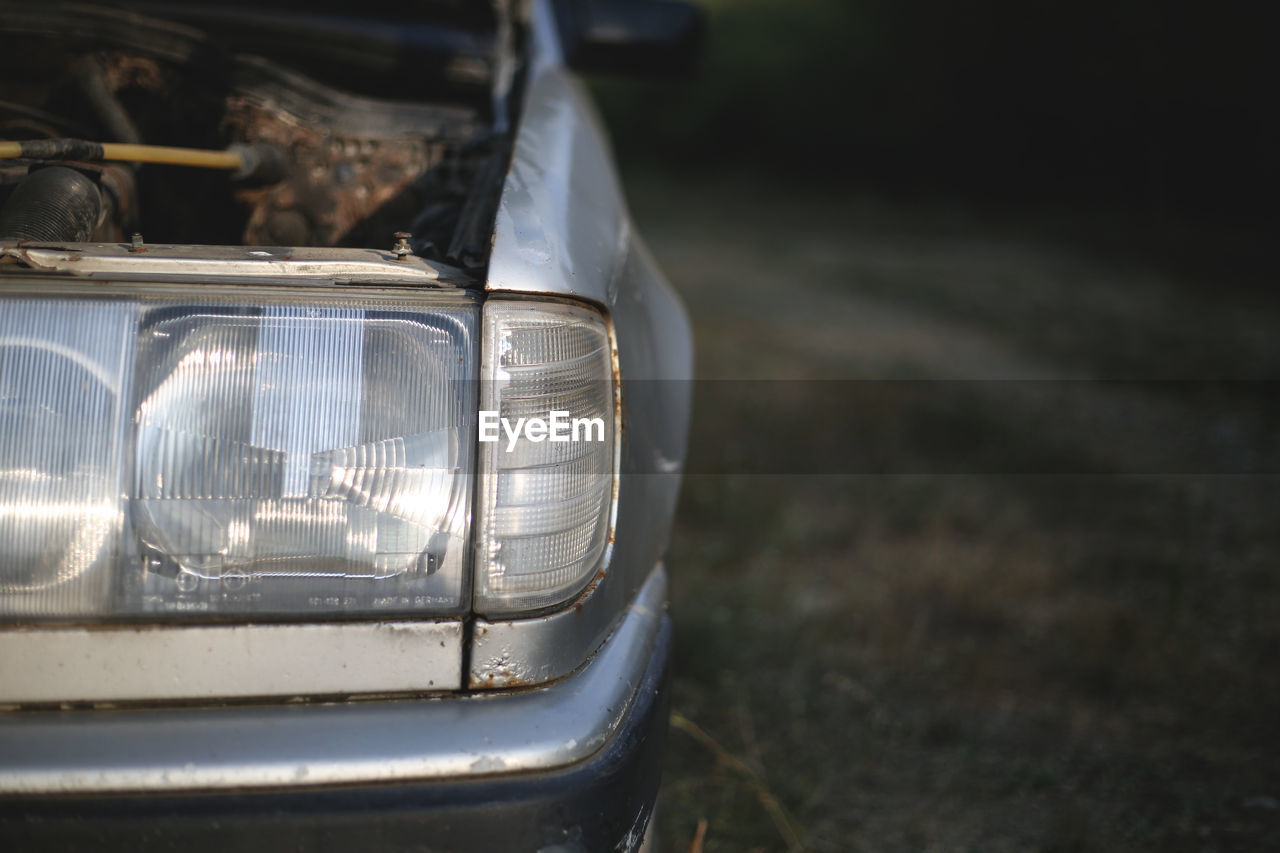 Close-up of abandoned car outdoors