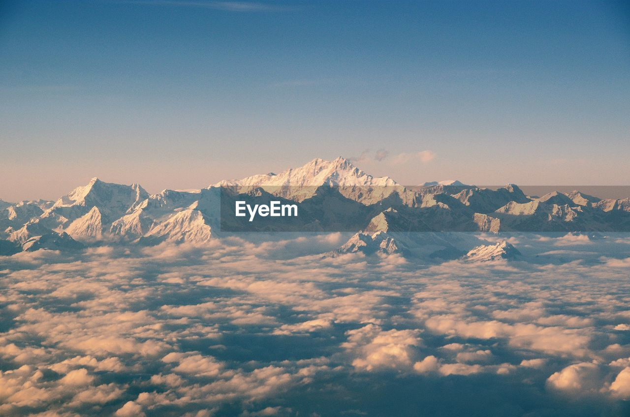 Aerial View Of Clouds Against Snowcapped Mountains
