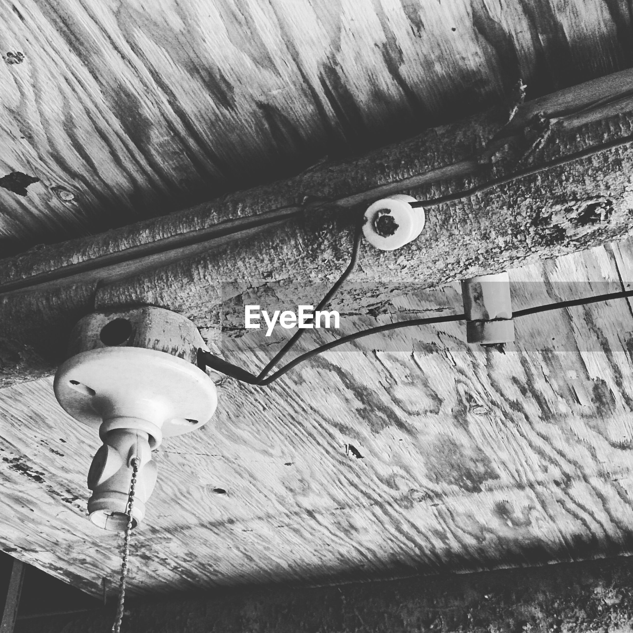 Low angle view of bulb holder on ceiling
