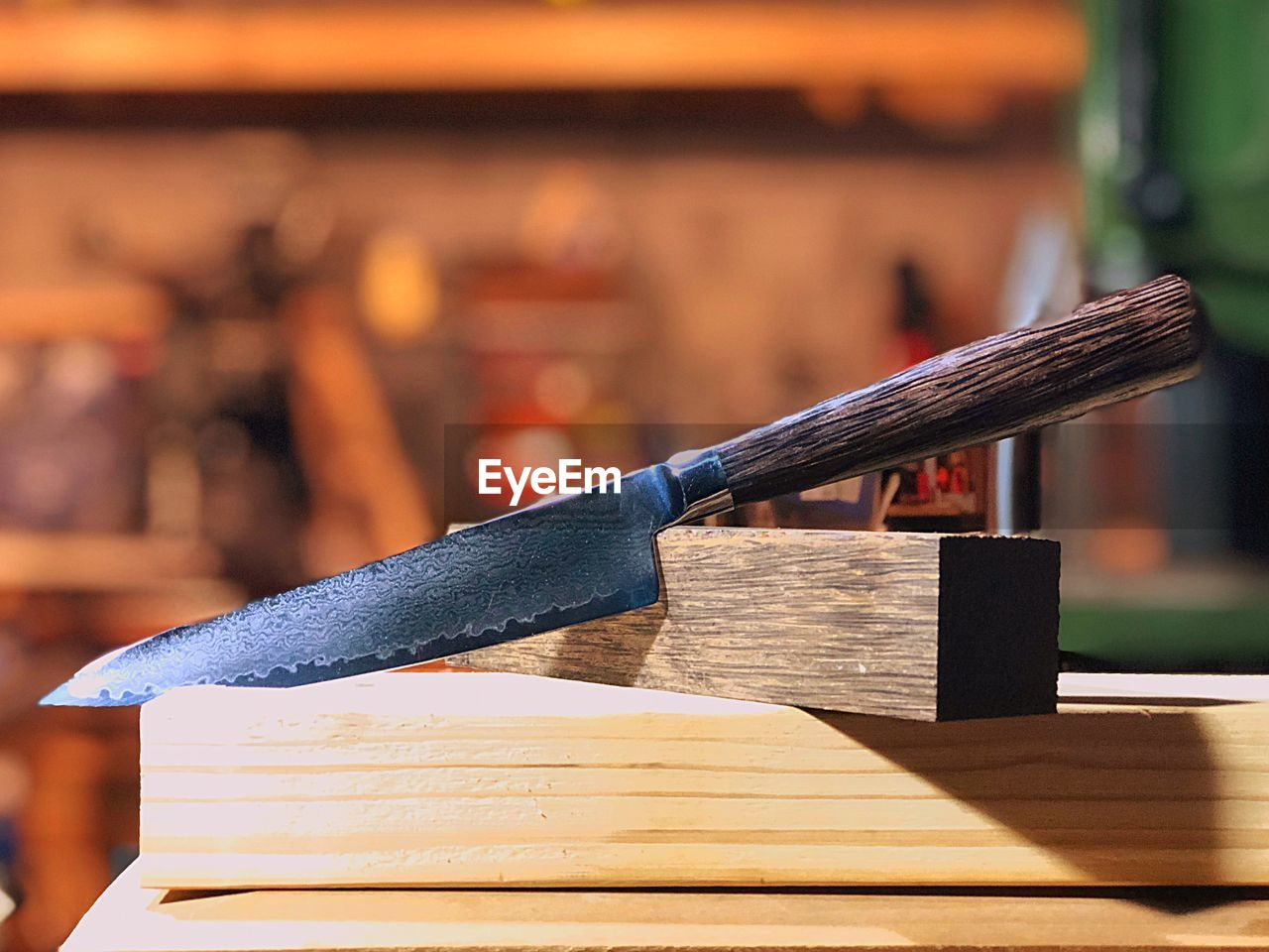 wood - material, focus on foreground, table, book, publication, still life, close-up, indoors, no people, education, wisdom, literature, stack, workshop, tool, sunlight, selective focus, day, group of objects, hand tool, hardcover book