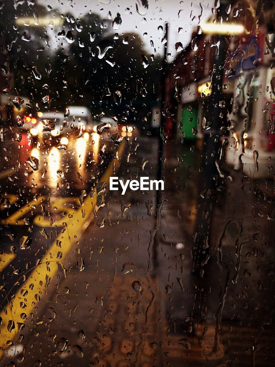 Full frame image of wet glass window with rain