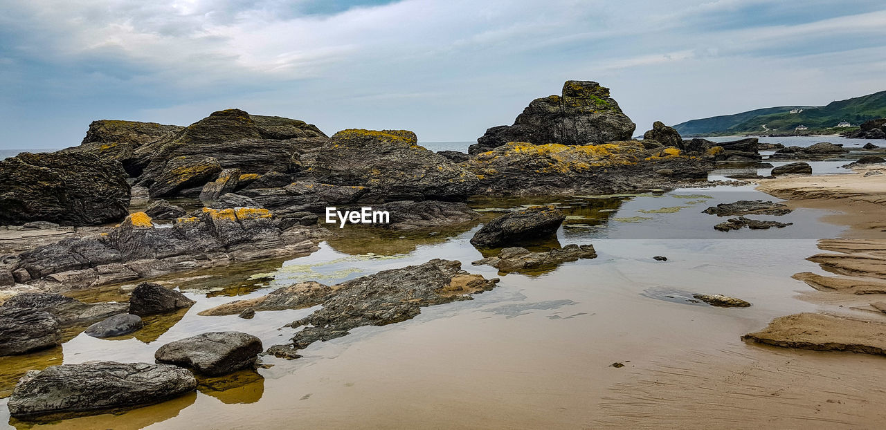 rock, sky, rock - object, solid, water, beauty in nature, rock formation, scenics - nature, sea, cloud - sky, land, nature, beach, tranquility, tranquil scene, no people, day, non-urban scene, idyllic, outdoors, stack rock