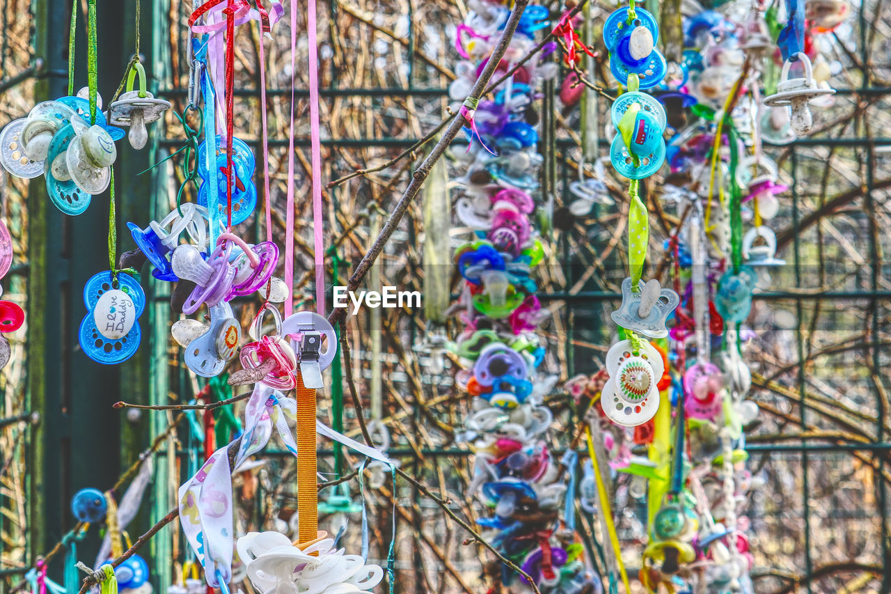 multi colored, hanging, no people, choice, day, focus on foreground, variation, large group of objects, art and craft, creativity, for sale, close-up, abundance, retail, outdoors, market, selective focus, decoration, collection, business