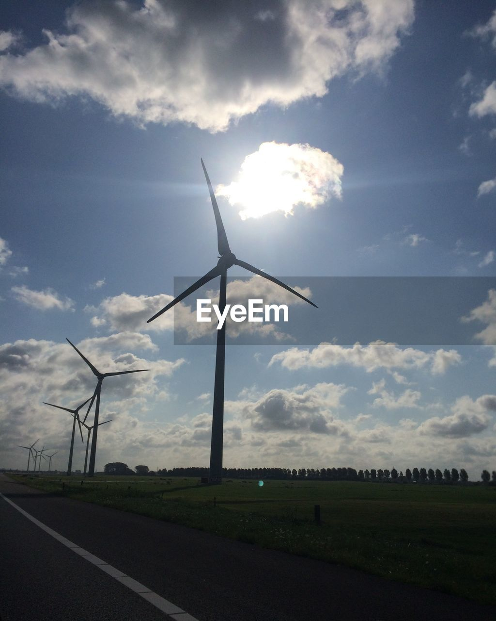 environmental conservation, alternative energy, wind turbine, wind power, renewable energy, cloud - sky, fuel and power generation, sky, windmill, industrial windmill, field, nature, outdoors, day, landscape, no people, rural scene, scenics, technology, beauty in nature