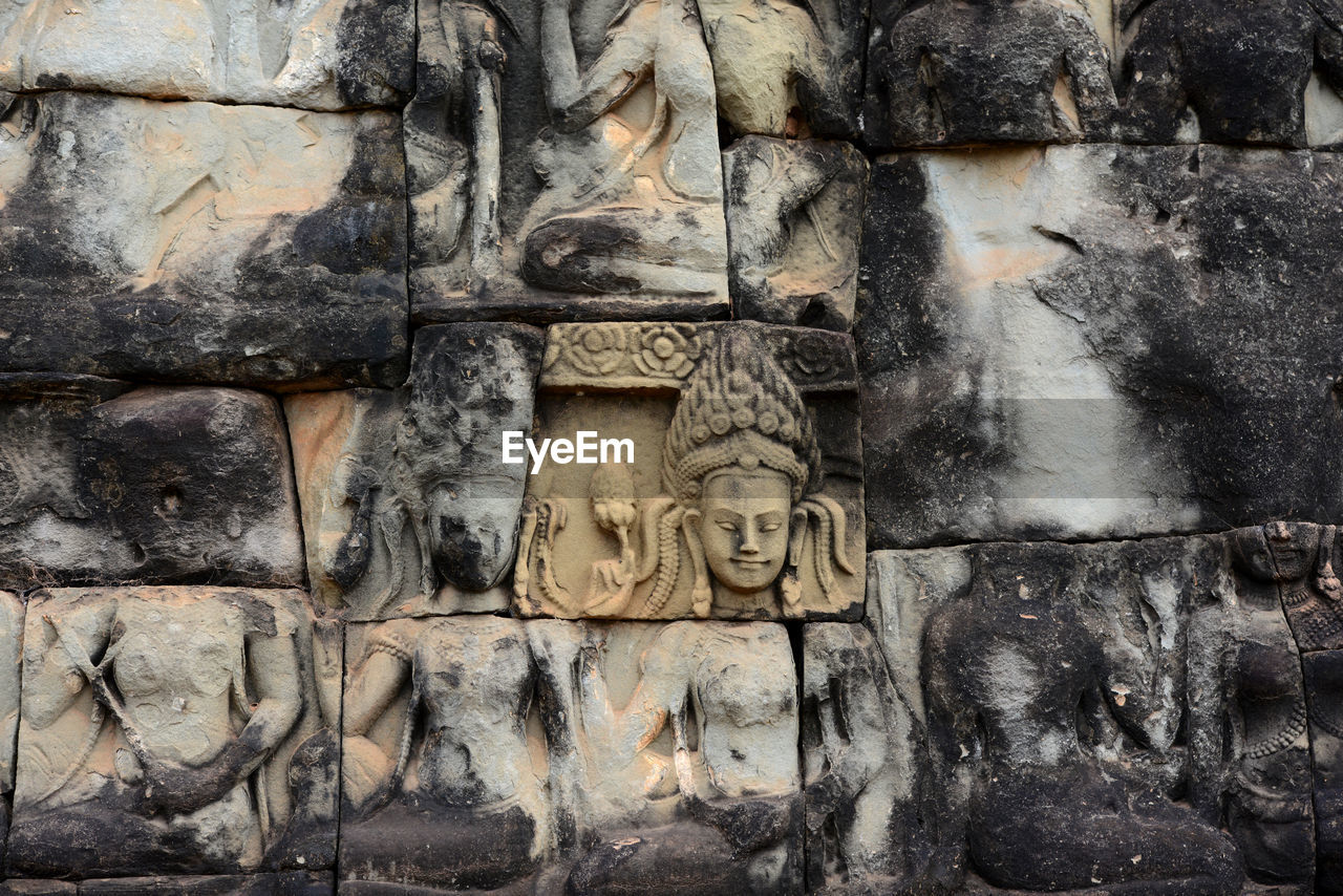 human representation, sculpture, male likeness, art and craft, statue, carving - craft product, stone material, bas relief, history, ancient, no people, architecture, built structure, outdoors, travel destinations, old ruin, day, building exterior, ancient civilization, close-up
