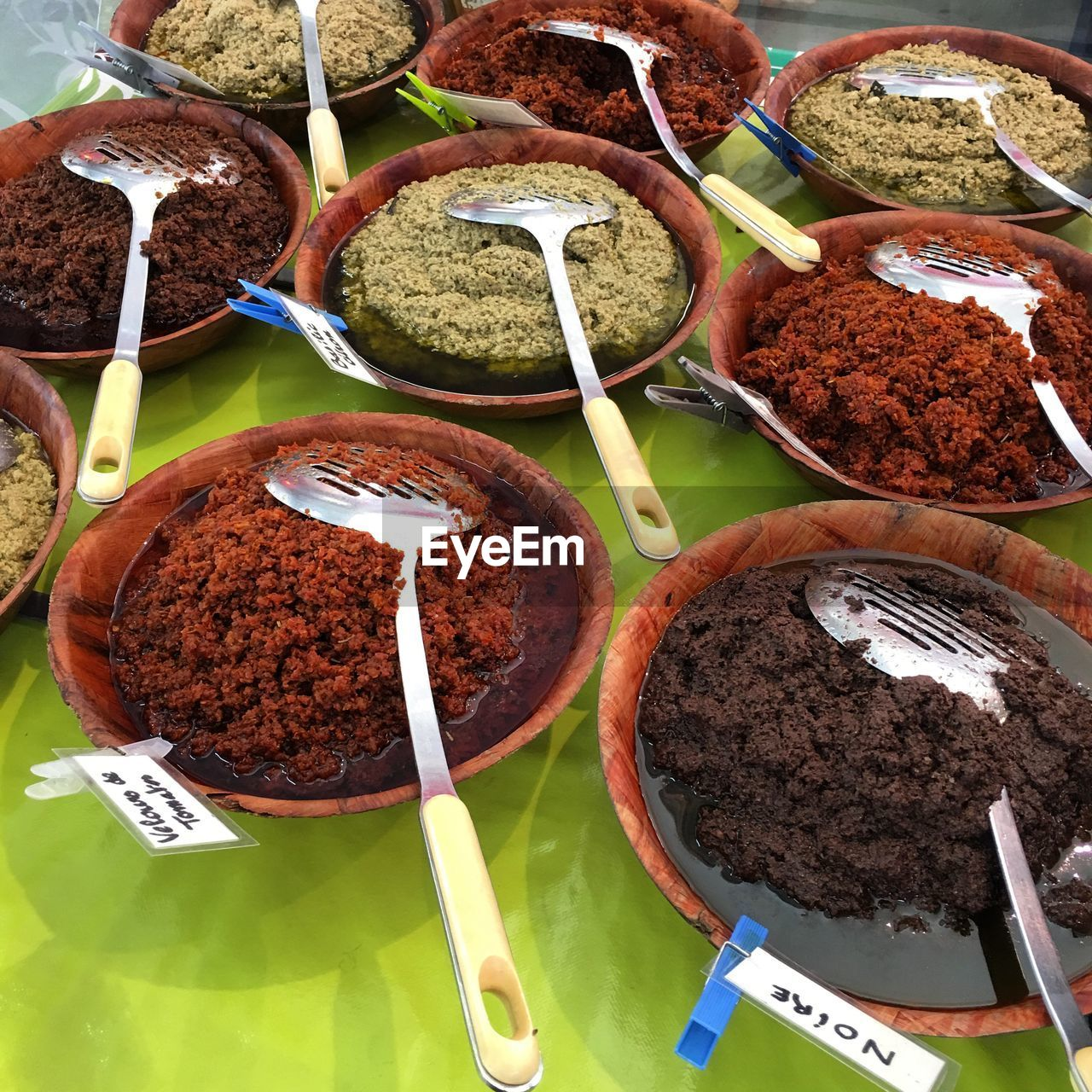 Close-Up Of Various Spices With Labels In Bowls On Table For Sale